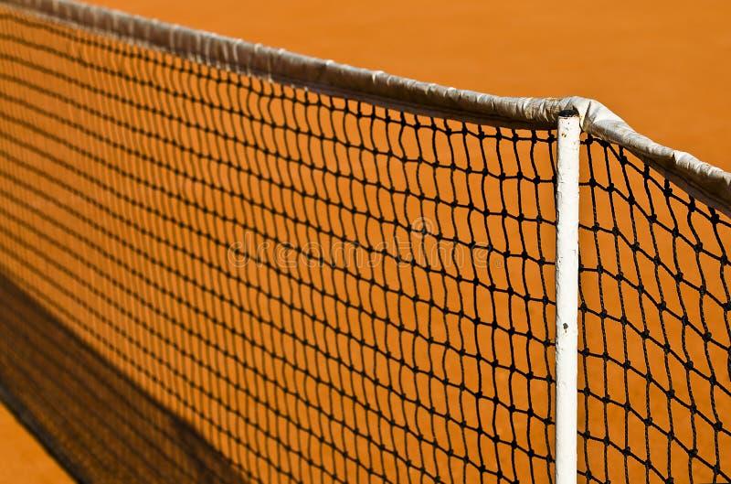Rede e argila do tênis foto de stock royalty free