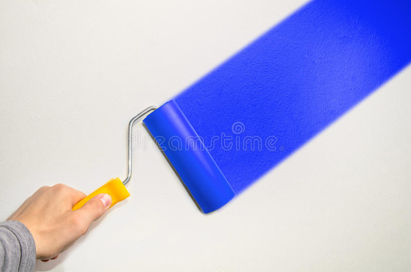 Redecoration. Hand hold roll tool for painting or burnishing , finishing work royalty free stock photography