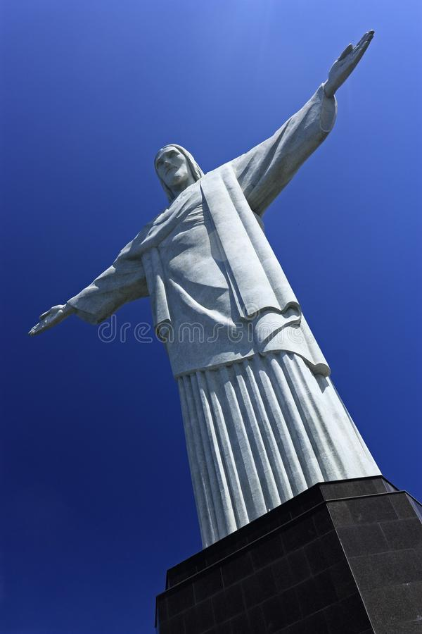 REDEEMER CHRIST, RIO DE JANEIRO, BRAZIL - APRIL 06, 2011: Bottom view of the Christ Redeemer´s Statue. The deep blue sky behind. stock photos