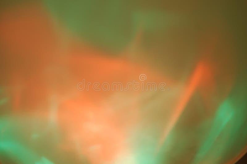 Redemoinho verde alaranjado fundo iluminado da cor fotos de stock