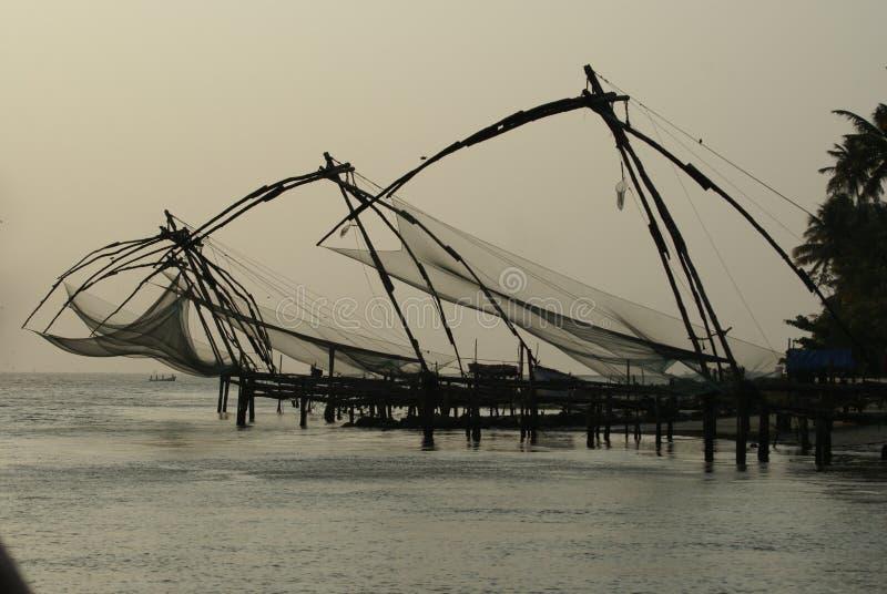 Redes de pesca de Kerala la India fotografía de archivo