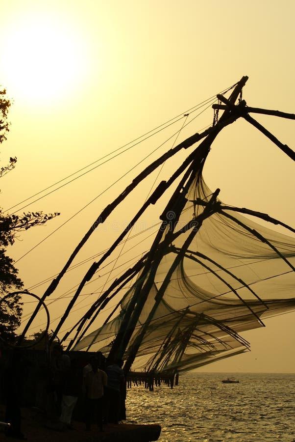 Redes de pesca de Kerala la India fotos de archivo