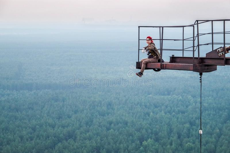 A stalker sitting on top of the overhorizon antenna array DUGA in Chernobyl zone royalty free stock image