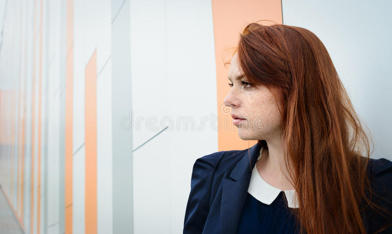 Redhair woman with freckles outside office break. Redhair woman with freckles like business lady outside office break stock images