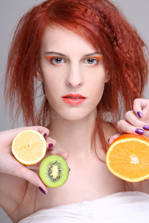 Redhaired Girl With Orange, Lemon And Kiwi Stock Photos
