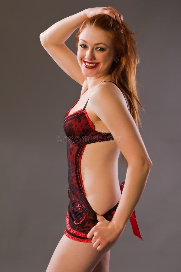 Download Redhead foto de stock. Imagem de freckles, fêmea, undergarments - 12806918