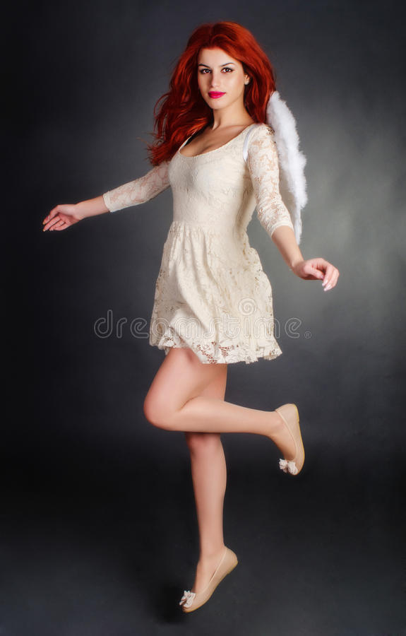 Download Redhead angel stock photo. Image of valentines, floating - 29021874
