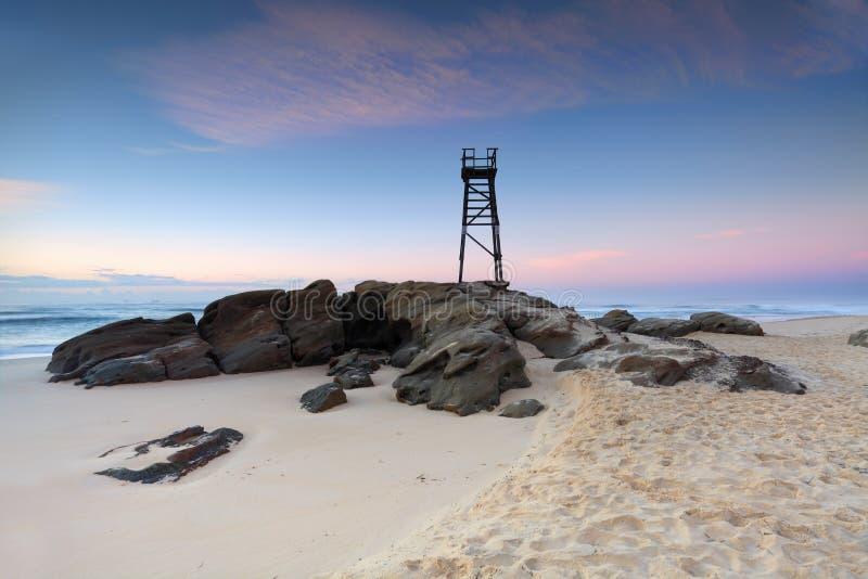 Redhead Beach, NSW Australia just before sunrise. Redhead Beach, a coastal suburb of Lake Macquarie, NSW, Australia with shark tower just before sunrise, pretty royalty free stock photography