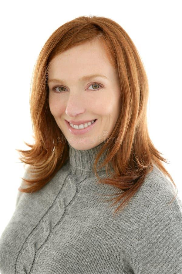 Redhead beautiful woman portrait smiling stock image