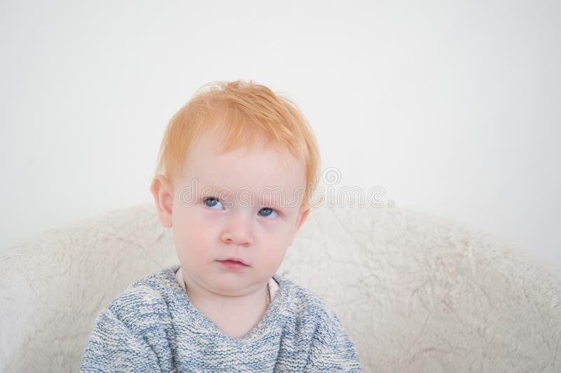 Redhead boy is thinking royalty free stock photography