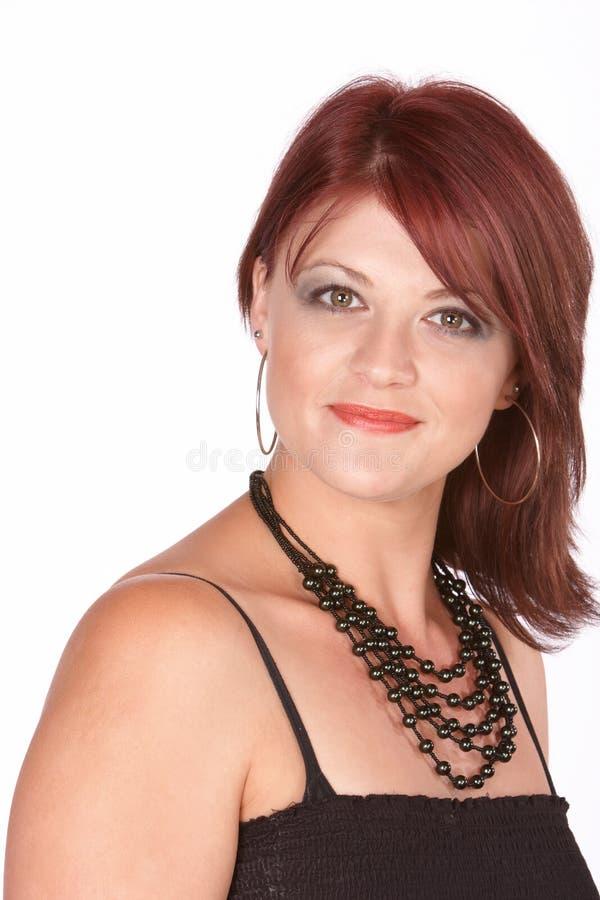 Redhead con il sorriso timido immagini stock