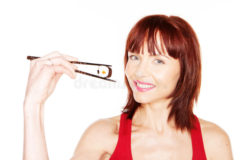 Download Redhead Female With Chopsticks Stock Photo - Image: 23878224