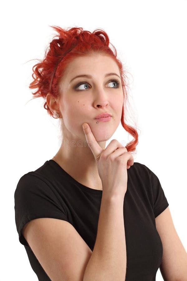 Redhead female thinking stock photo