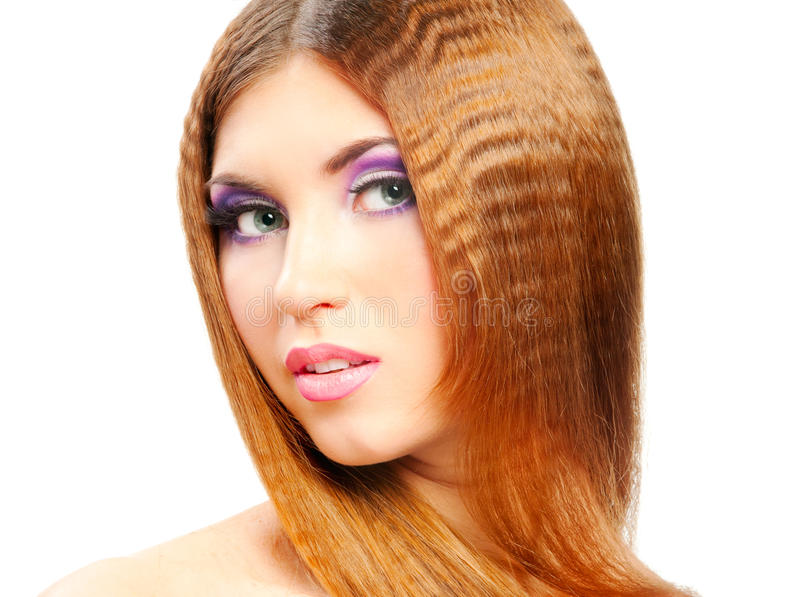 Redhead girl. Young beautiful woman with long hair royalty free stock images