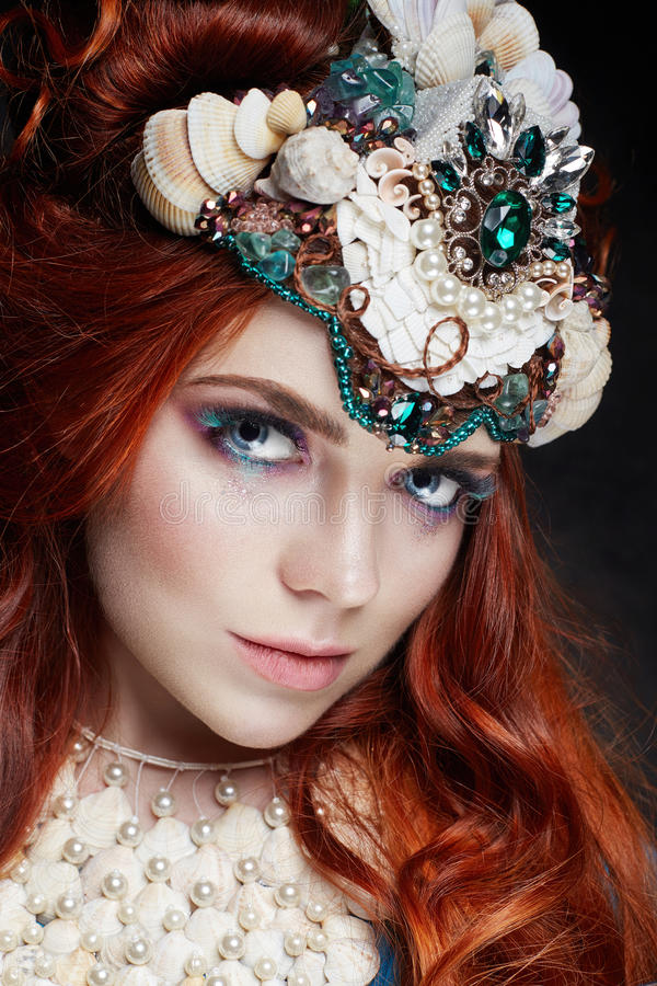 Redhead girl with bright makeup and big lashes. Mysterious fairy woman with red hair. Big eyes and colored shadows, long lashes. Look, pure skin care, care stock images