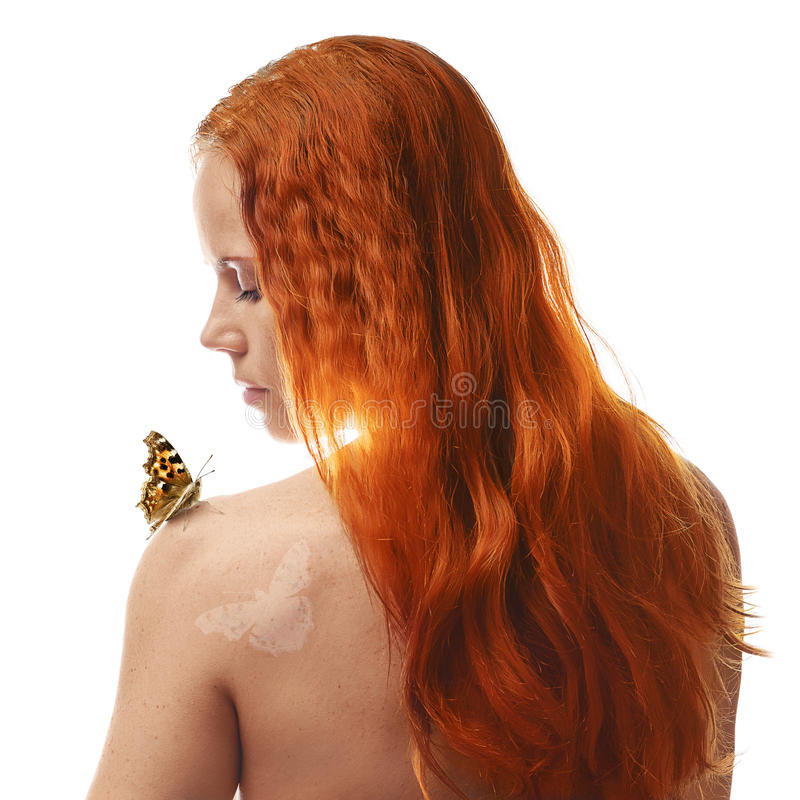 Redhead girl with butterfly stock image