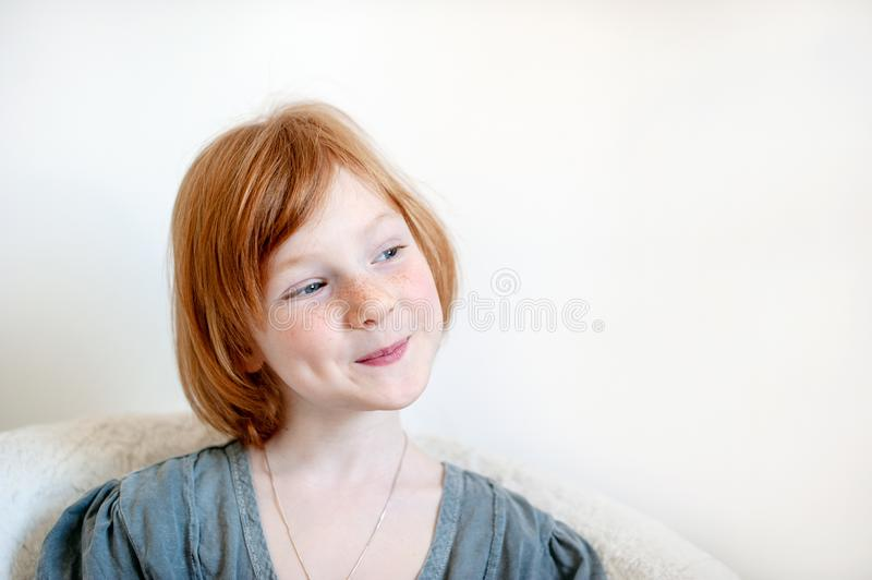 A girl with a dimple on her cheek. A redhead girl with a dimple on her cheek royalty free stock photo