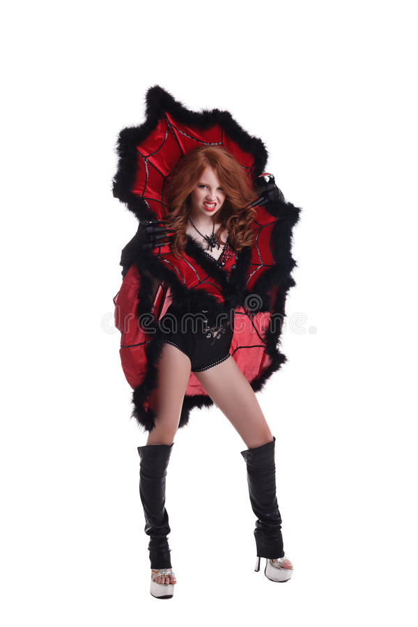 Redhead girl dressed as Evil Queen bares her teeth. Redhead young girl dressed as Evil Queen bares her teeth stock images