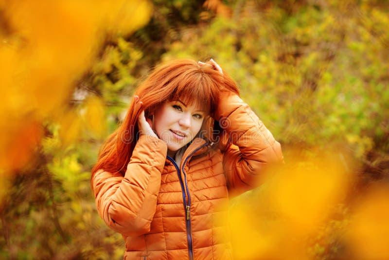 Redhead girl in fall stock photography