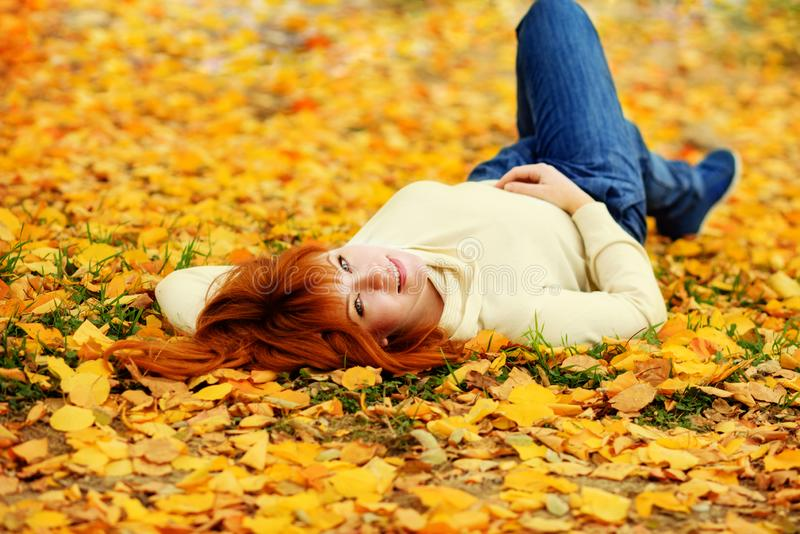 Redhead girl  in fall stock images