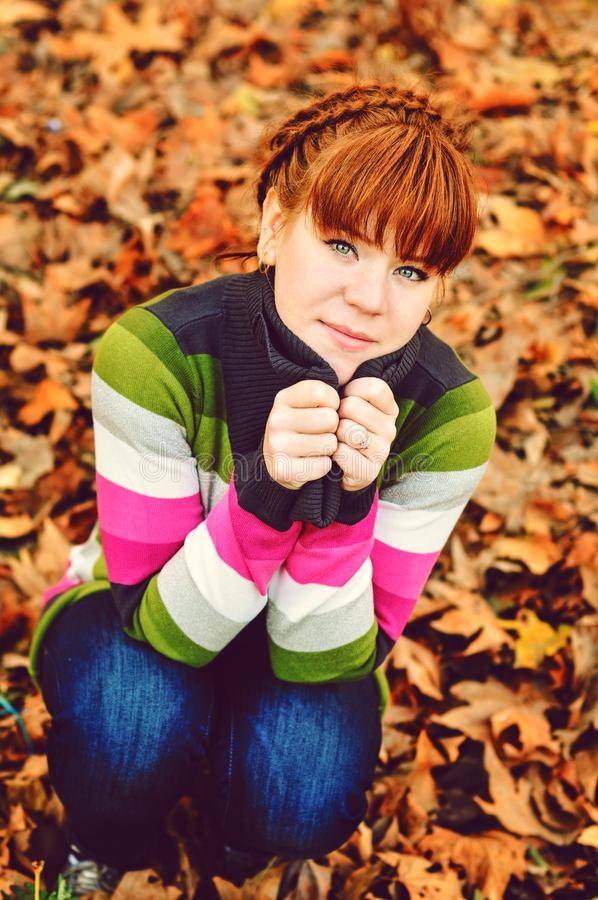 Redhead girl  in fall royalty free stock photography