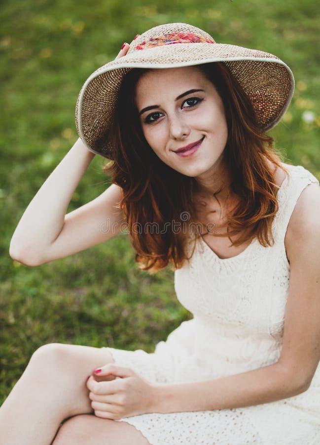 Girl at green grass at village outdoor. royalty free stock photos
