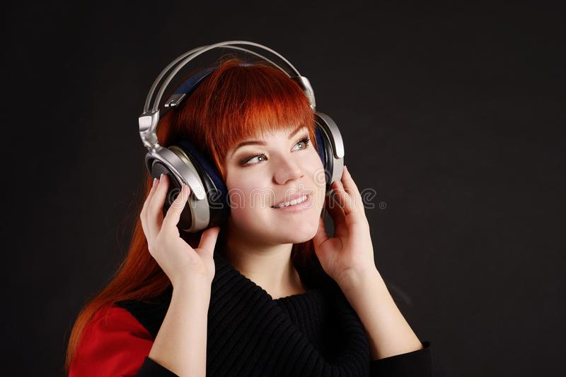 Redhead girl with headphone royalty free stock photos