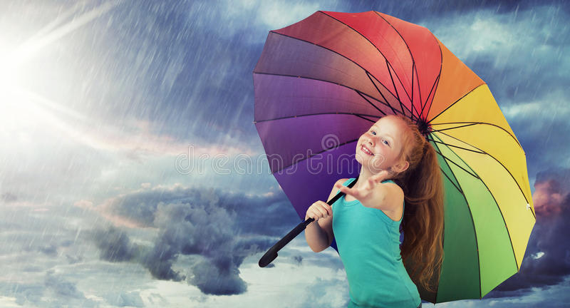 Redhead girl in the heavy rain. Ginger girl in the heavy rain royalty free stock images