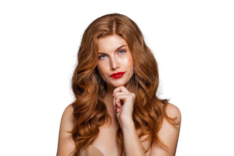Redhead girl isolated on white background. Funny face. Doubt and choice concept. Expressive facial expressions stock images