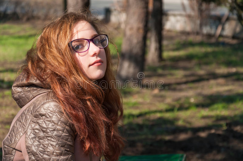 Redhead girl outdoors in autumn stock photo