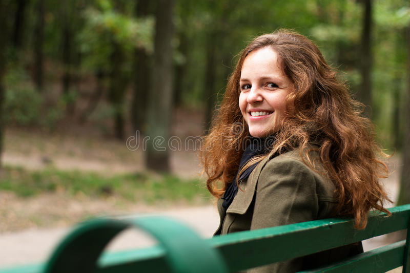 Redhead girl in park stock image