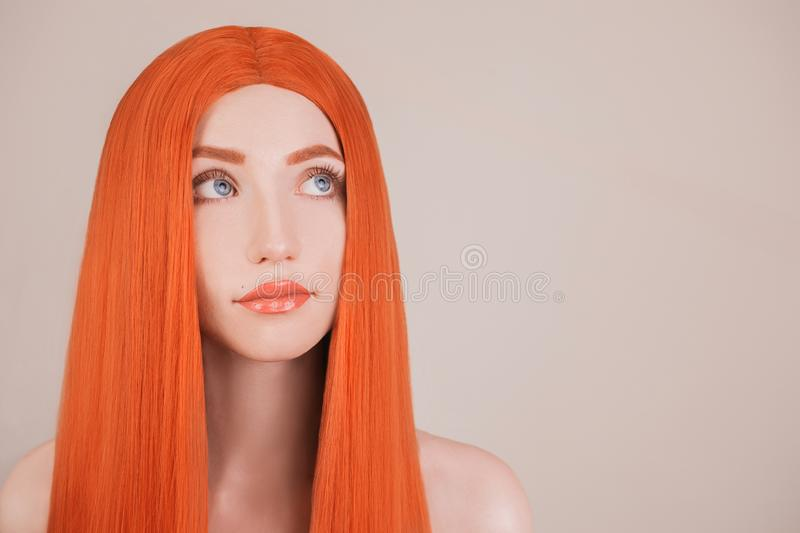 Redhead girl with perfect hair. Natural beauty. Portrait of young girl with perfect skin. Hair rejuvenation. Hair straightening. K. Eratin straightening. Redhead royalty free stock photos