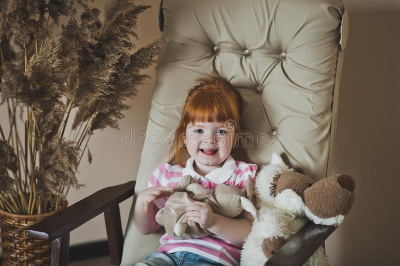 Fiery little girl playing with a toy wolf 4380. royalty free stock photography