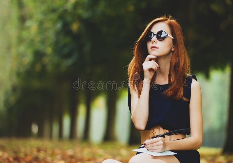 Redhead girl in Versailles park royalty free stock photo