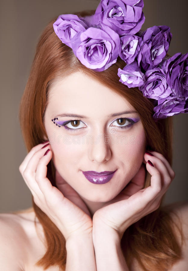 Redhead girl with style make-up and flowers. Portrait of beautiful redhead girl with style make-up and flowers. 1 royalty free stock photo