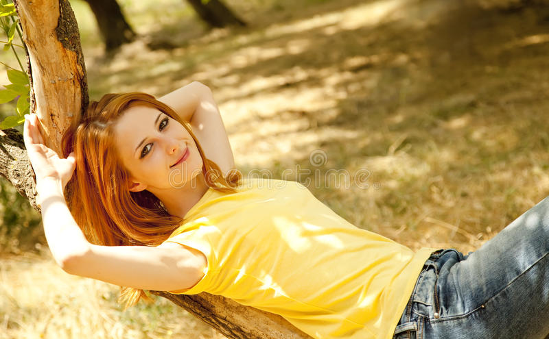 Redhead girl at summer park.