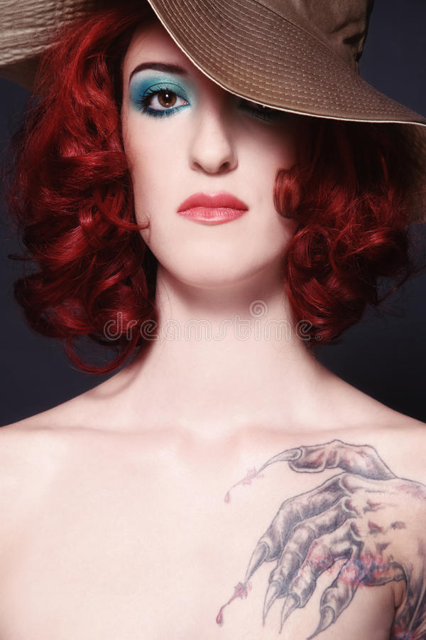 Redhead girl with tattoo royalty free stock photography