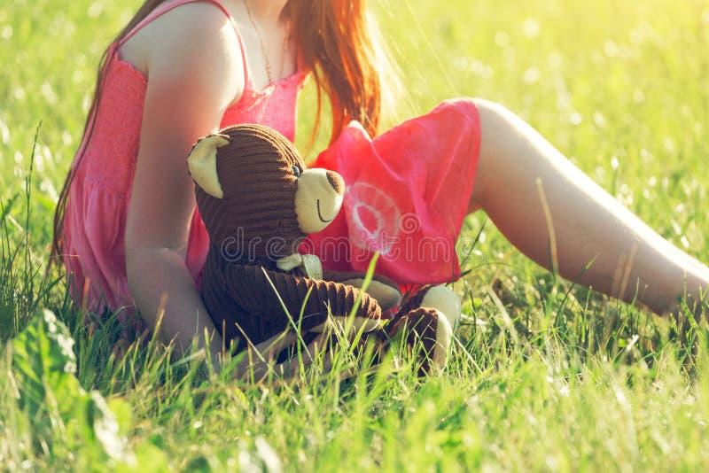 Redhead girl with teddy bear stock photo