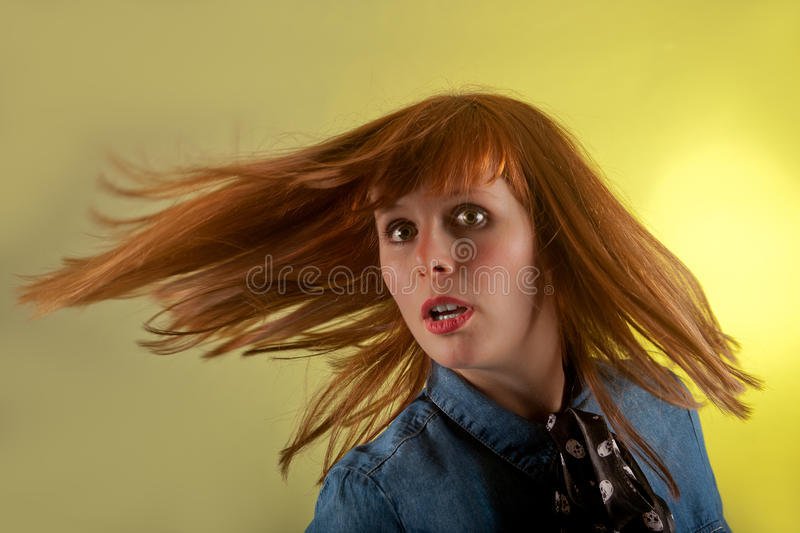 Redhead girl yellow surprized background royalty free stock photography