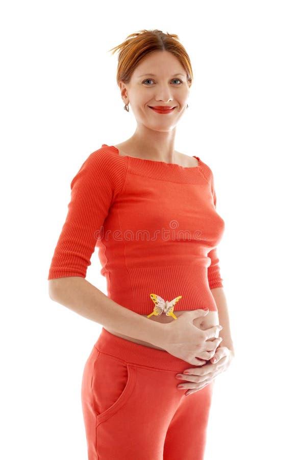 Redhead grávido com butterfl fotos de stock
