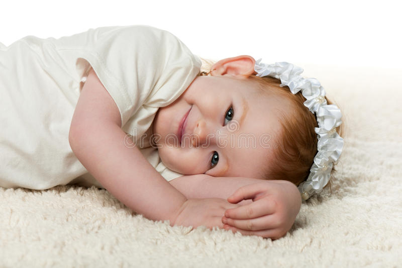 Redhead little girl on the carpet stock image