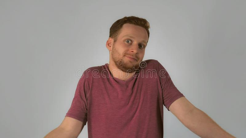 Redhead male shows feeling miscommunication royalty free stock images