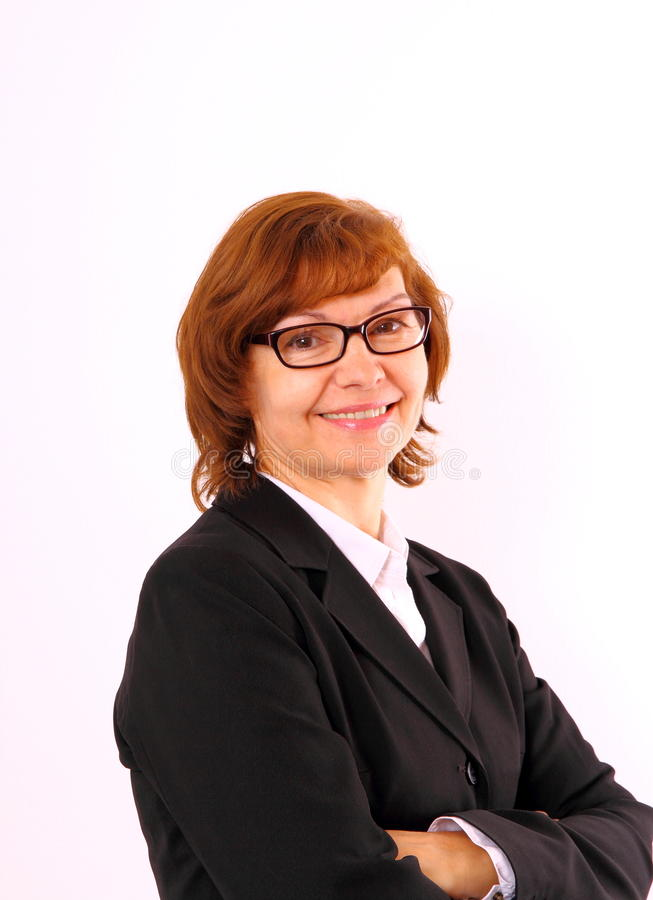 Redhead mature business woman with eyeglasses. Close up stock images