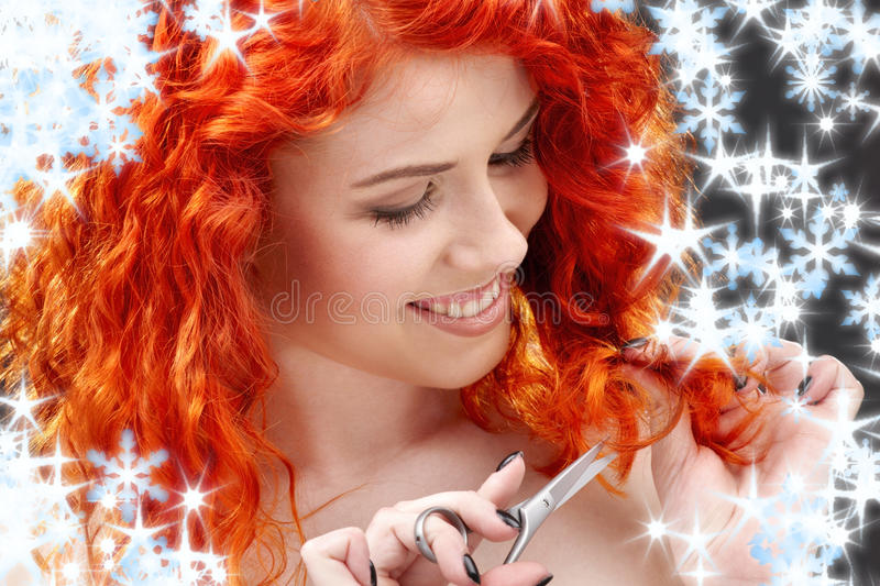 Redhead with scissors. Picture of lovely redhead with scissors and snowflakes royalty free stock images