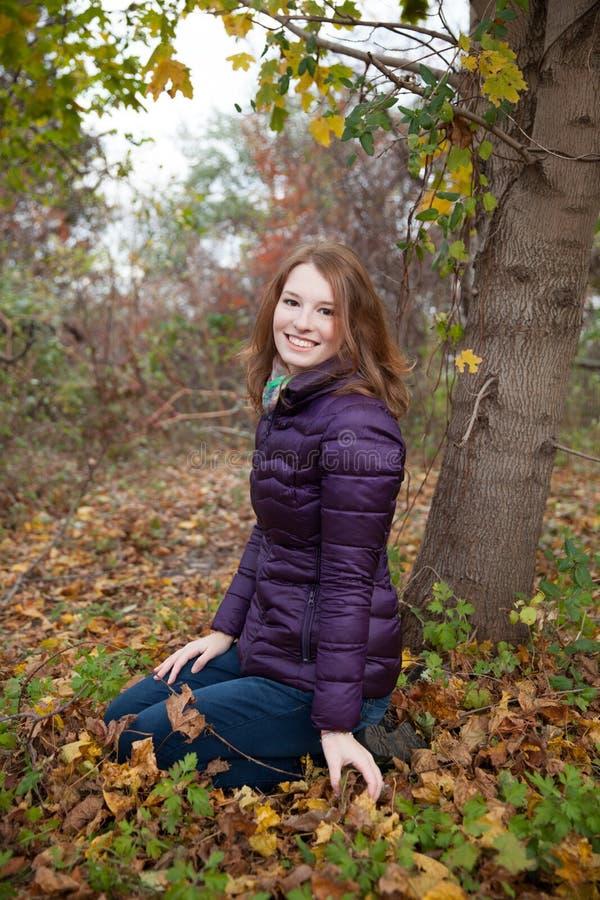 Redhead outside enjoying autumn royalty free stock image