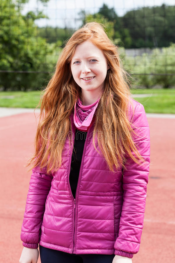 Redhead teenage girl in pink royalty free stock photos