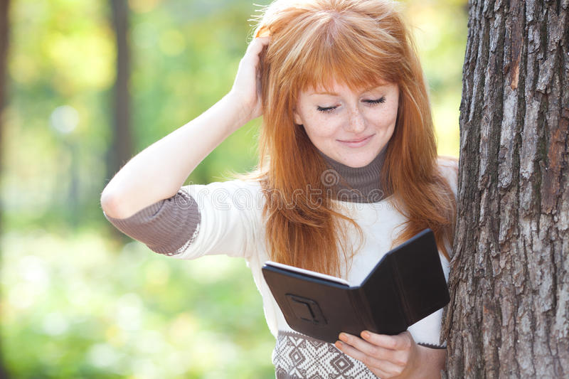 Download Redhead Teenager Woman Reading A Book Stock Image - Image: 27713645
