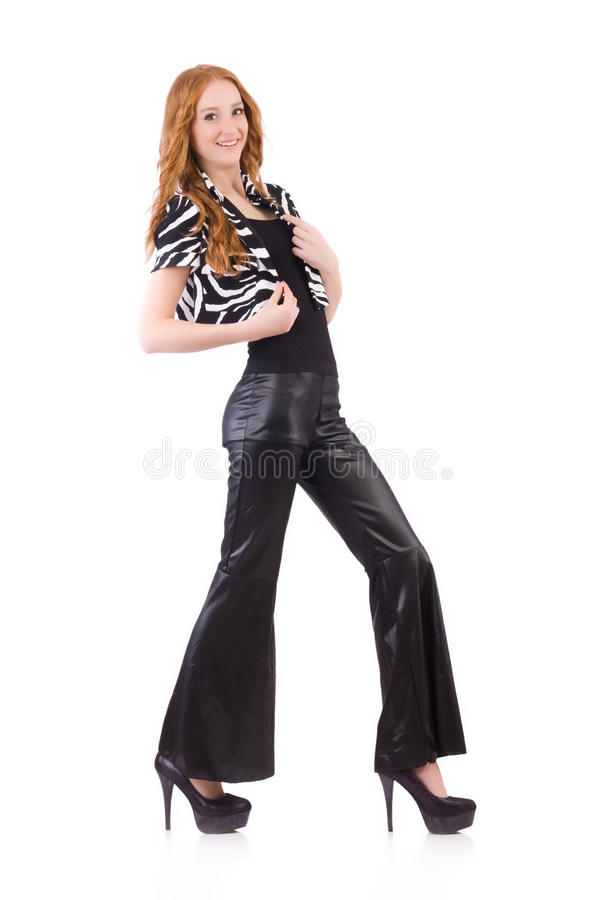 Redhead woman in black bell bottom pants stock image