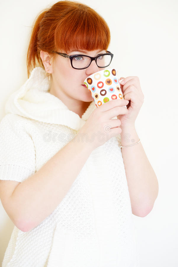 Redhead woman with cup stock photography