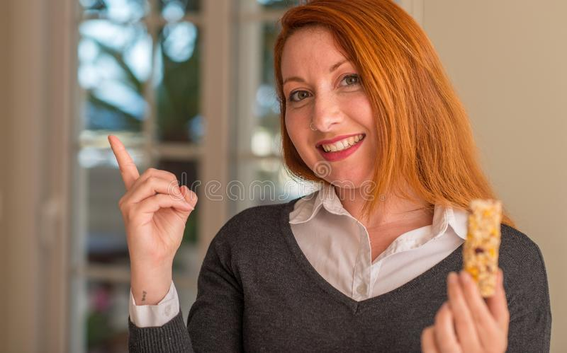 Young beautiful redhead woman at home stock photography